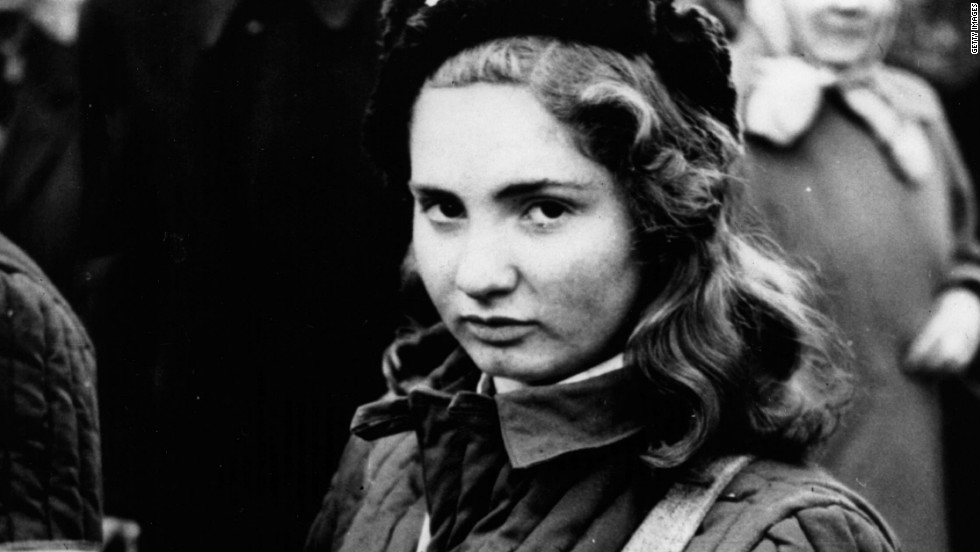 A 15-year-old Hungarian girl armed with a machine gun during protests against the country's communist rulers.