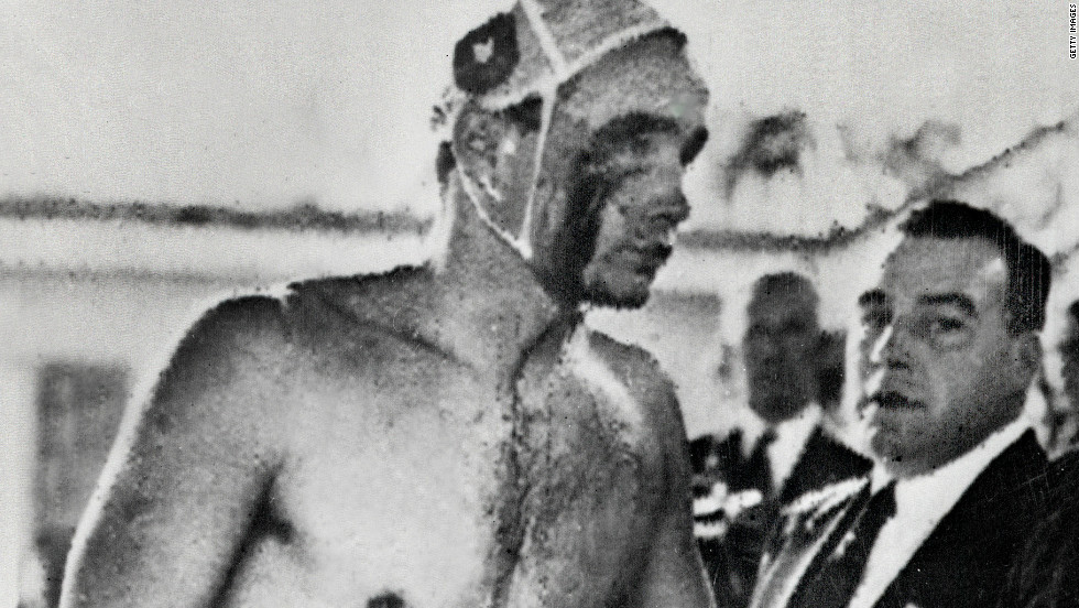 "Ervin Zador, Hungary's 21-year-old water polo star, emerges from the Olympic swimming pool in Melbourne with blood pouring from a cut beneath his right eye. The ""blood in the water"" match against the Soviet Union in December 1956 came to represent Hungary's bloody struggle against its Communist oppressors."