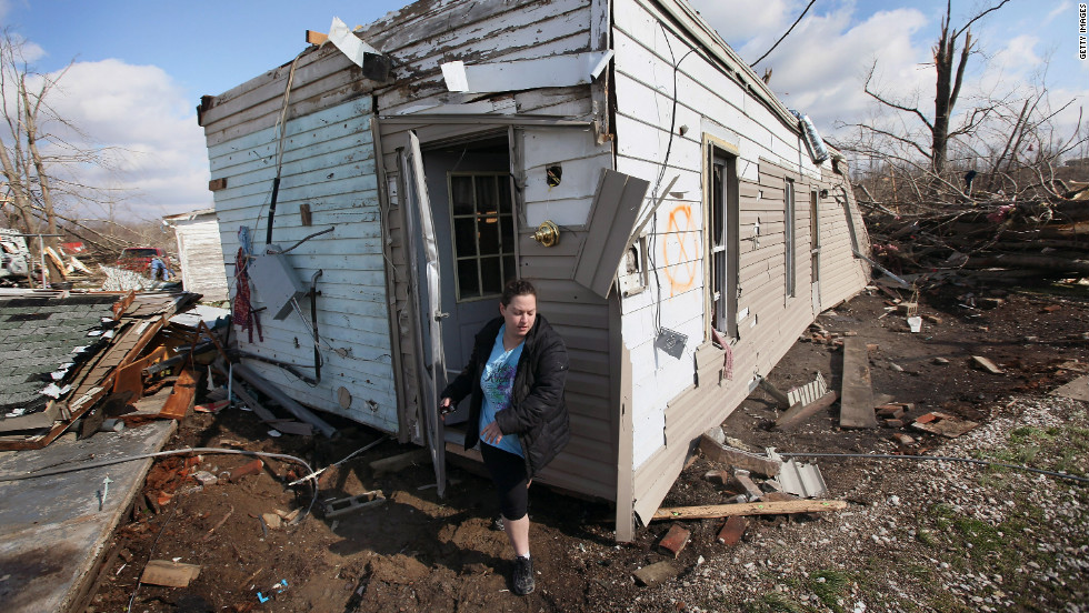 Sarah Kutz helps her sister rescue possessions from her home, which was destroyed in the tornado that hit Henryville.