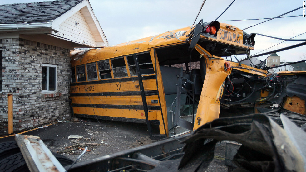 A school bus is lodged in a home in Henryville where it came to rest after being tossed by Friday's tornado.