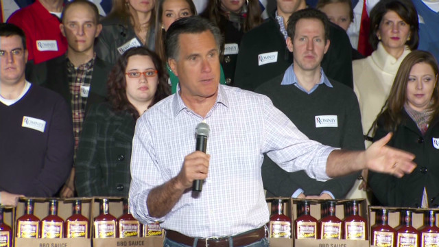 Romney takes aim at Obama