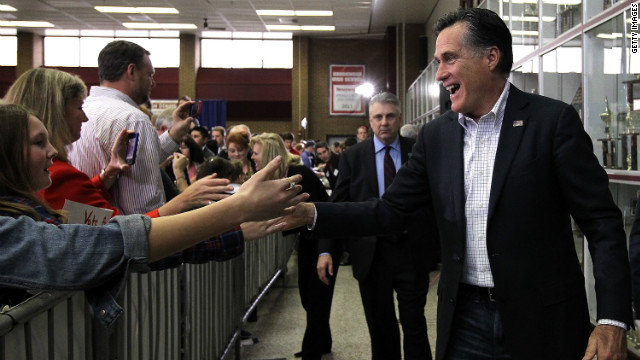 Republican presidential candidate Mitt Romney greets supporters at a pancake breakfast Sunday in Snellville, Georgia.