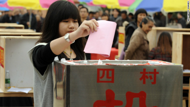 Woman honors father in China election