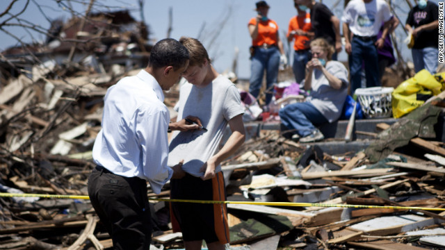 President Obama signs a youth's shirt during a May 2011 visit to tornado-ravaged Joplin, Missouri.