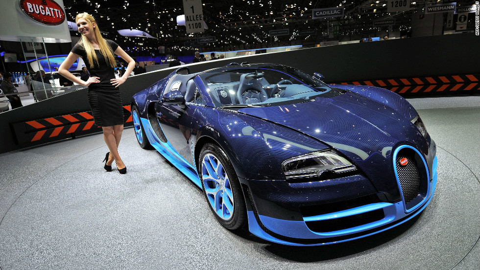 A Bugatti Veyron Grand Sport Vitesse, which has a top speed of 255 miles per hour, is exhibited on a rotating stand.