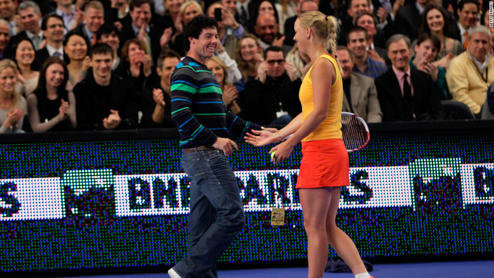 Love match. Caroline Wozniacki welcomes her boyfriend Rory McIlroy onto the court at Madison Square Garden.