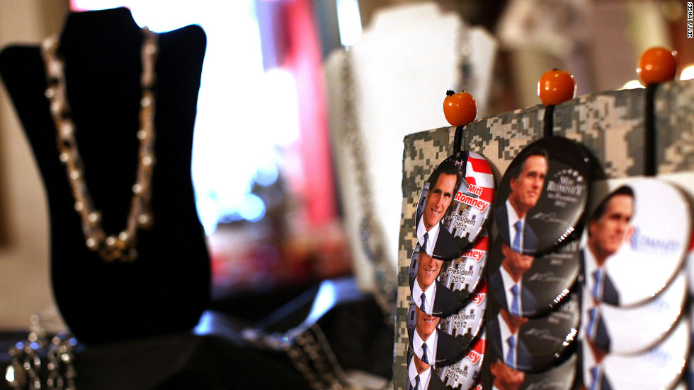 Mitt Romney campaign buttons are displayed next to jewelry during a campaign rally at Bryan's Place on Tuesday in Zanesville, Ohio.