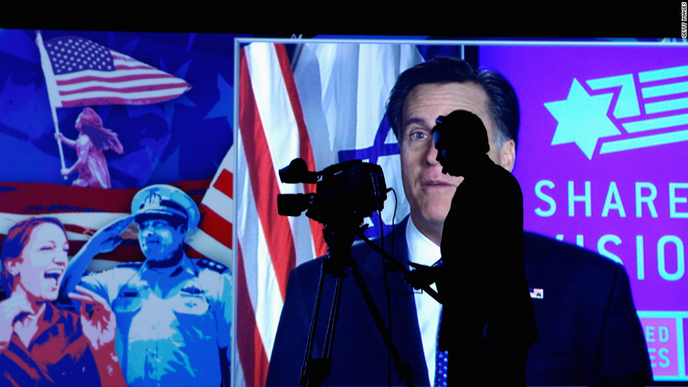 Mitt Romney addresses the American Israel Public Affairs Committee's annual policy conference via a satellite link Tuesday at the Washington Convention Center.