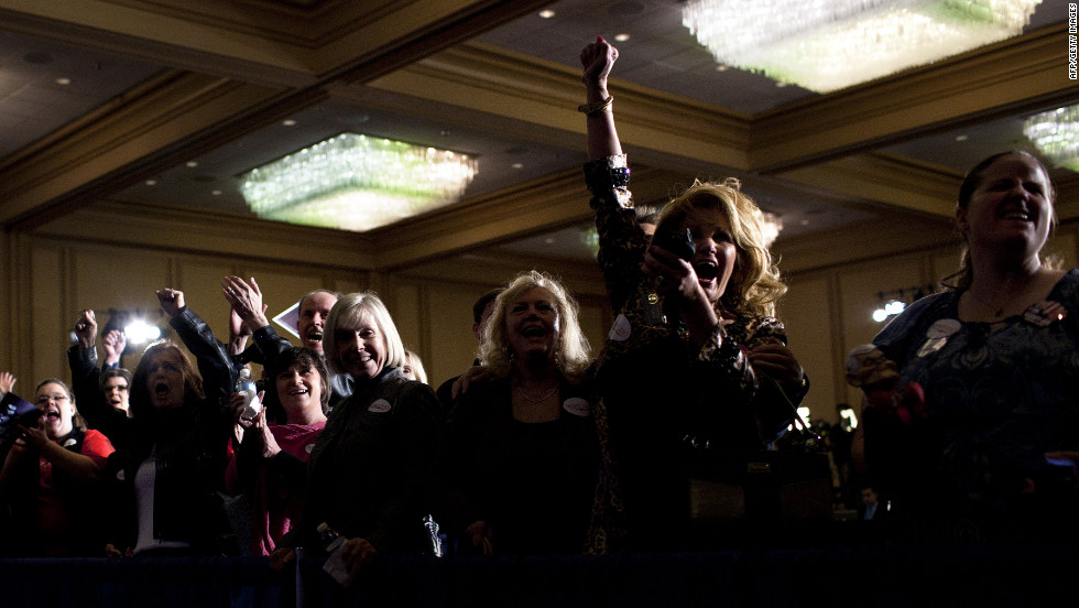 Supporters of Newt Gingrich cheer Tuesday during a rally in Atlanta as a TV network projects Gingrich winning the Georgia Republican primary.