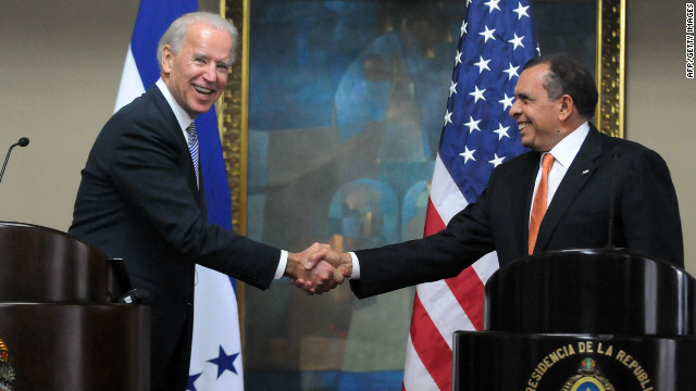 US Vice President Joe Biden, left, shakes hands with Honduran President Porfirio Lobo in Tegucigalpa on Tuesday.