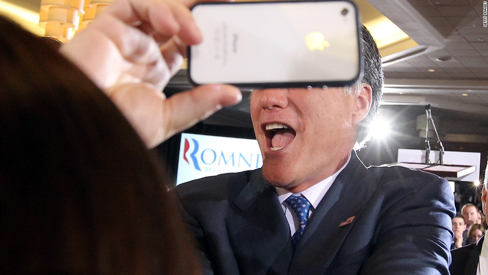 A supporter snaps a photo of Romney in Boston.