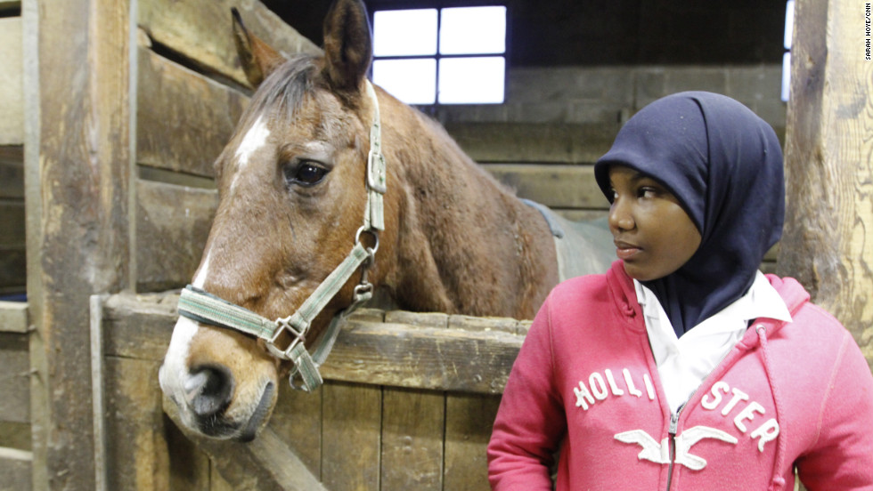 Sihgerra Myers, 14, takes a break from stable duties on a recent Friday night. Myers is a member of the Work To Ride women's polo team.