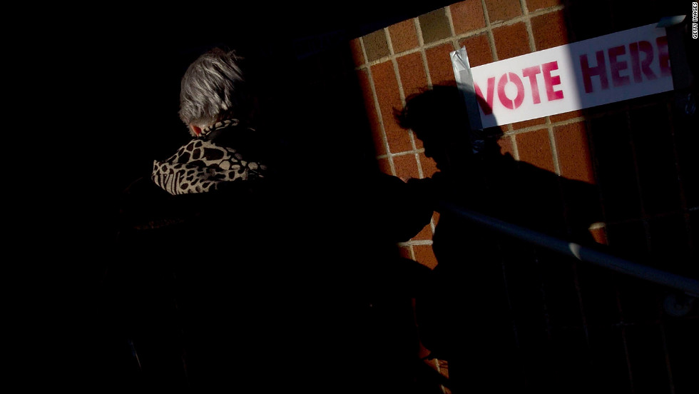 A voter enters a polling station to cast a ballot in the Republican presidential primary Tuesday at the Russell Apartments in Cambridge, Massachusetts.