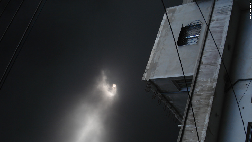 Dense smoke blocks the sun from shining in Homs, the Syrian city that has been the center of a military crackdown on anti-reginme activists.