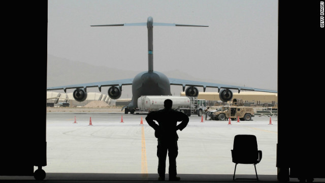 A member of the Afghan air force stands in the doorway of a hangar in Kandahar, Afghanistan, on July 3, 2010.