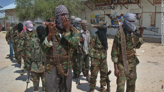 Al-Shabaab recruits walk down a street in Mogadishu, Somalia. The group is blamed for attacks and kidnappings of foreigners in Kenya.