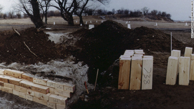 A 1992 photos shows the coffins of babies being buried in a trench on Hart Island.