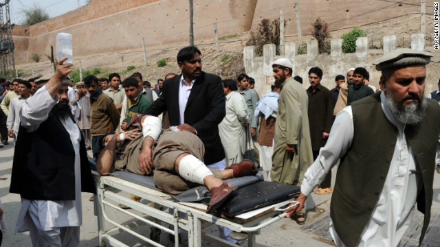 Relatives shift an injured suicide attack victim outside a hospital near Peshawar, Pakistan on March 11, 2012.