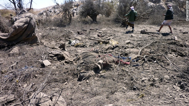 Yemenis inspect the scene of military airstrikes in a mountainous area of the Al-Bayda province on Saturday.