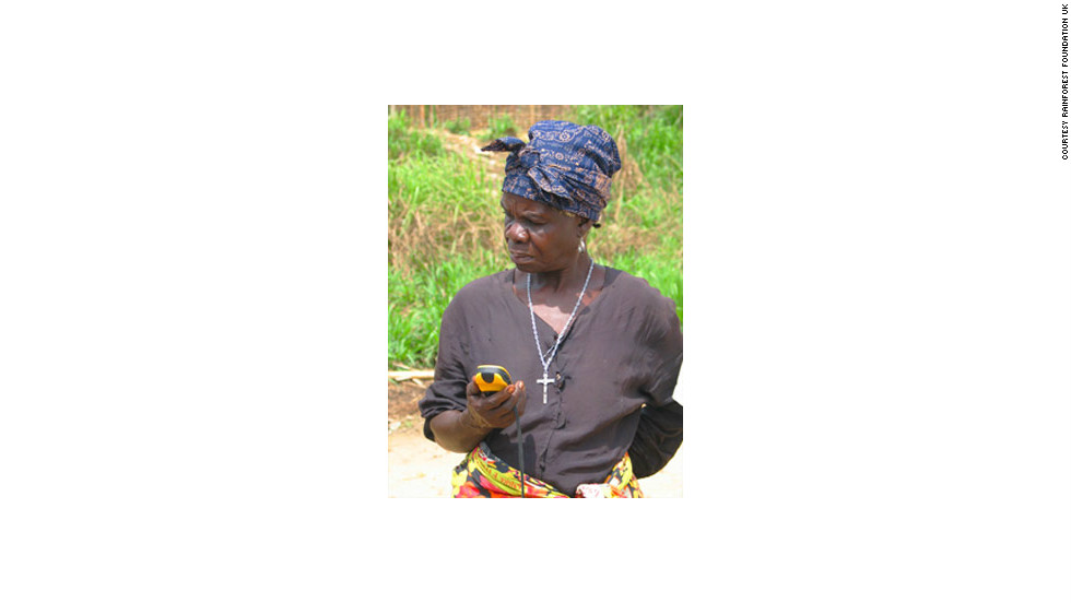 A woman uses a GPS device on a mapping project in the DRC.