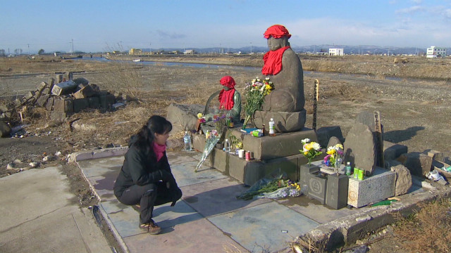 Japan pauses to remember tragedy