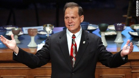 Alabama's chief justice Roy Moore was suspended without pay Friday for the rest of his term for directing probate judges to enforce the state's ban on same-sex marriage.
