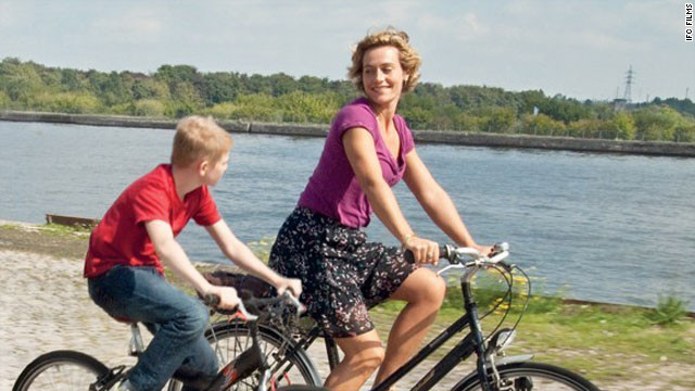 "Thomas Doret and Cecile De France star in ""The Kid with a Bike."""