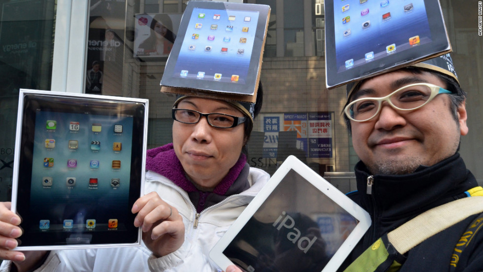 Two iPad enthusiasts show off their new purchases outside the Apple Store in Tokyo, Japan.