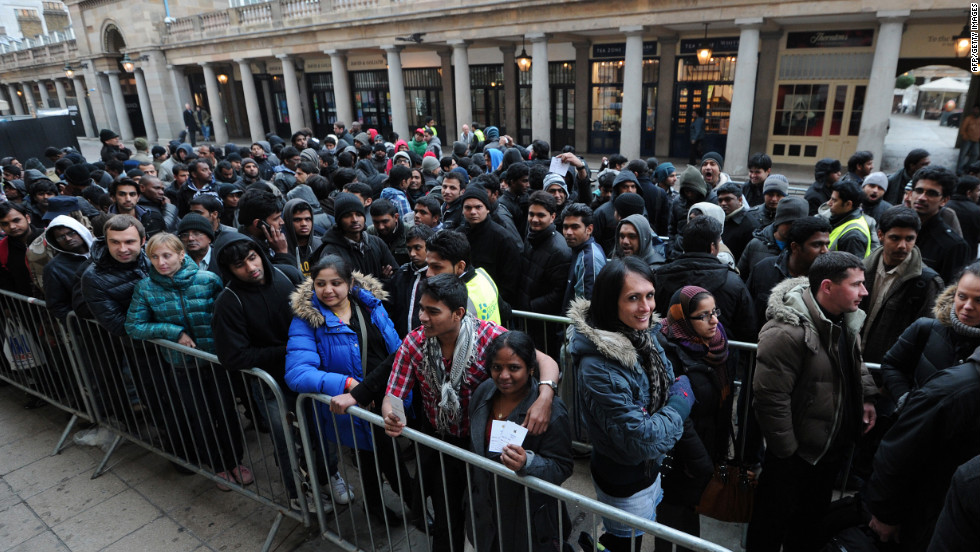 Customers in central London wait in a snaking line.