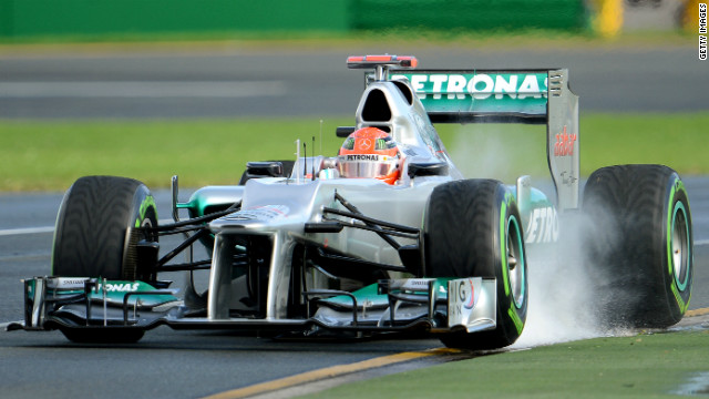 Seven-time world champion Michael Schumacher was fastest in wet practice conditions in Melbourne on Friday.