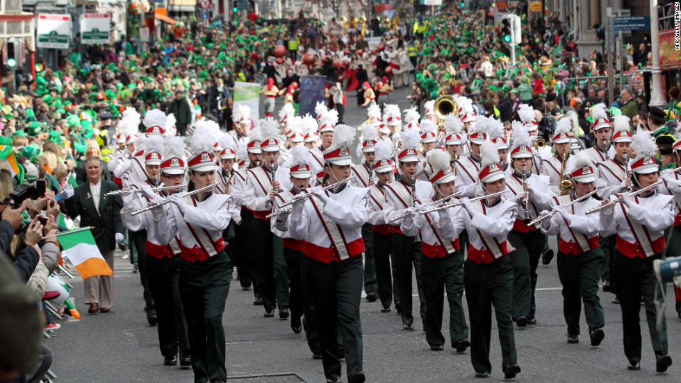 A band marches in the celebrations. Patron saints are chosen to protect the interests of a country, place, group, trade or profession, or activity, and to intercede for them in heaven.