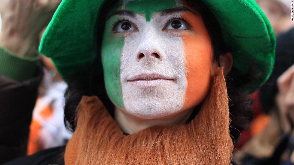 A parade-goer dressed as a leprechaun enjoys the Dublin festivities.