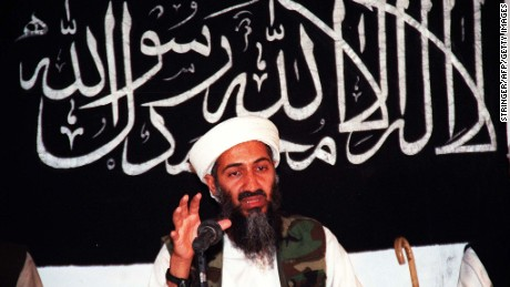 AFGHANISTAN - AUGUST 8:  Undated file picture of Saudi dissident Ossama Bin Ladin in an undisclosed place inside Afghanistan. Ossama Bin Ladin speaks while siting in front of a bannar inscribed basic Islamic tenet in Afghanistan. The billionaire Bin Ladin, member of a family of wealthy Saudi construction tycoon, is blamed for two bomb blasts in his home country in 1995-96 that killed 24 US servicemen. AFP PHOTO  (Photo credit should read AFP/AFP/Getty Images)