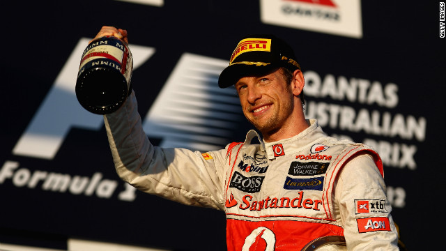 Jenson Button celebrates victory in the Australian Grand Prix, his third Melbourne win in four years.