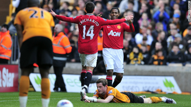 Javier Hernandez celebrates his first goal in Manchester United's 5-0 romp at Wolves.