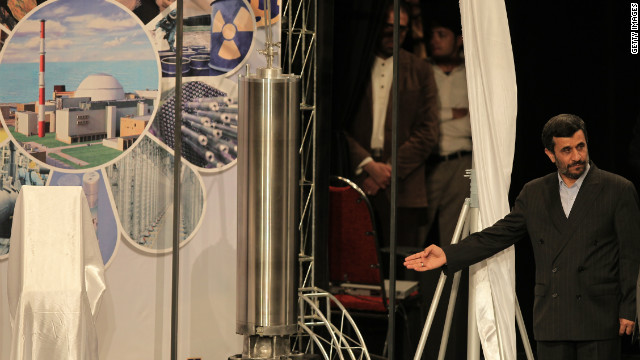 Iranian President Mahmoud Ahmadinejad unveils a sample centrifuge for uranium enrichment in Tehran on April 9, 2010.
