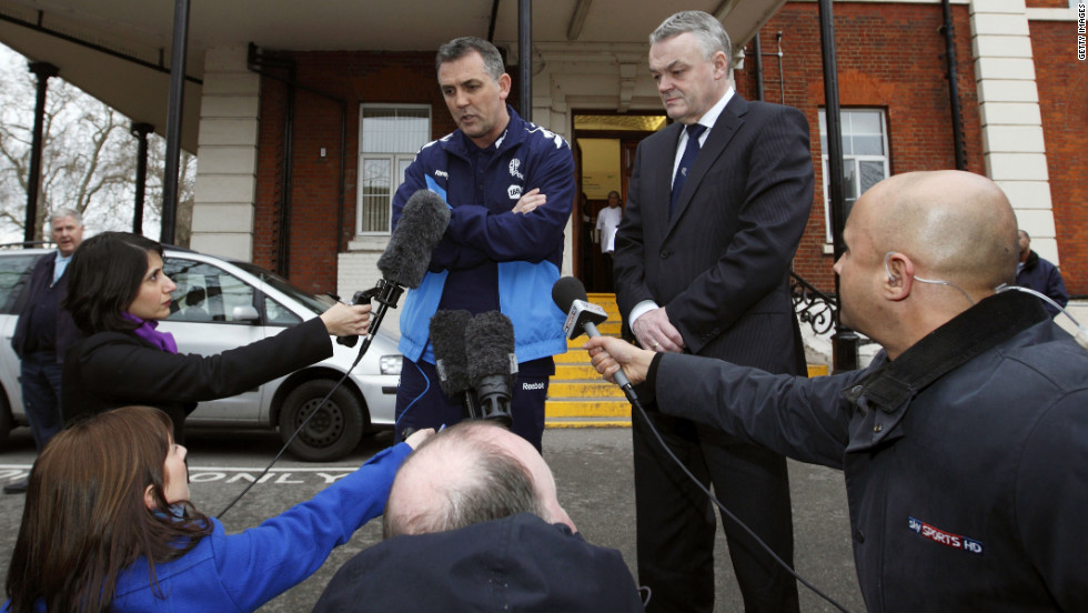 Bolton manager Owen Coyle (left) and chairman Phil Gartside outside the London Chest Hospital where Muamba is being treated.