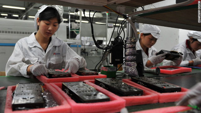 Workers inspect motherboards on a factory line at the Foxconn plant in Shenzen on May 26, 2010.