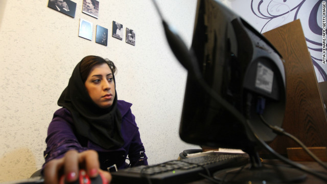 An Iranian woman surfs the internet at a cyber cafe in central Tehrah.
