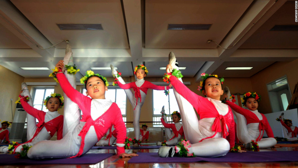 Like music, sport and education, ballet training starts young in China. Here, a group of Chinese children takes ballet class at an exclusive kindergarten in Beijing.