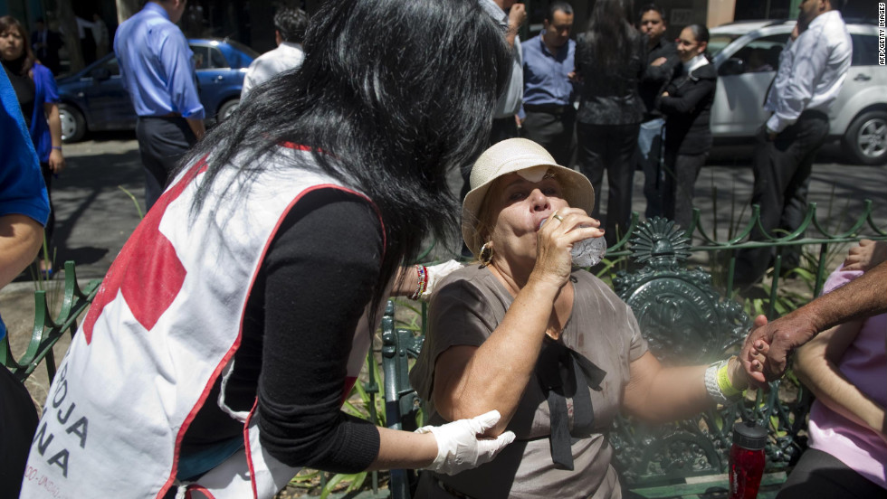 A member of the Mexican Red Cross assists a woman in Mexico City.