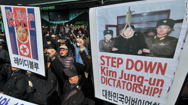 South Koreans shout during a rally denouncing the North's announcement of a planned satellite launch, in Seoul on March 20.