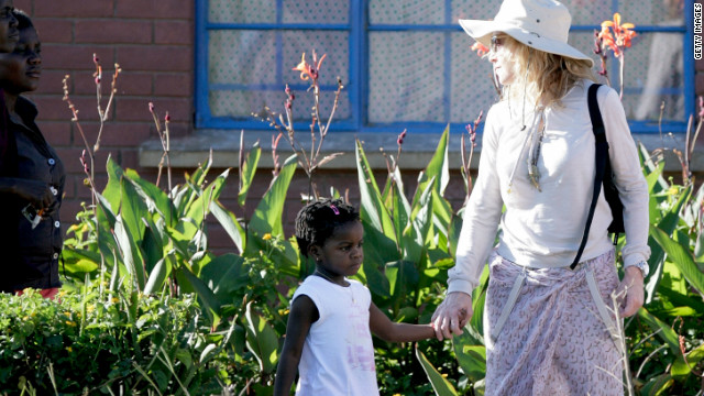 Madonna and her adopted Malawian daughter at one of the Raising Malawi initiative's in 2010 in Lilongwe, Malawi.