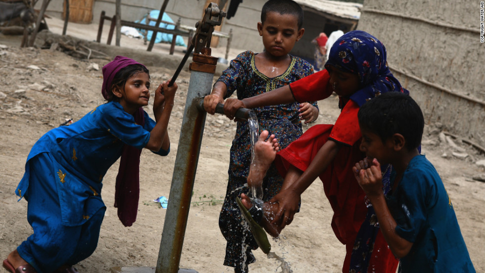 A group of girls wash themselves with water from a hand pump in the village of Gul Hasan Shaikh, Thatta, Pakistan.