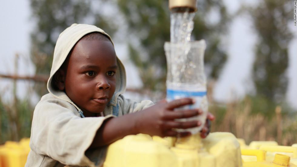 A boy collects water from an underground rainwater harvesting tank in Ntarama Orphan Village, Bugesera district, Rwanda.