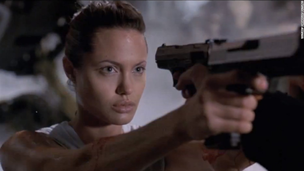 "Angelina Jolie brought the adventurer Lara Croft from video game to life in the film adaptation, ""Lara Croft: Tomb Raider"" (2001). In the movie, Croft fights to recover an ancient artifact called the Triangle from villains who want to control time and space. Jolie's action-packed performance received praise and led to the sequel ""Lara Croft Tomb Raider: The Cradle of Life"" in 2003."