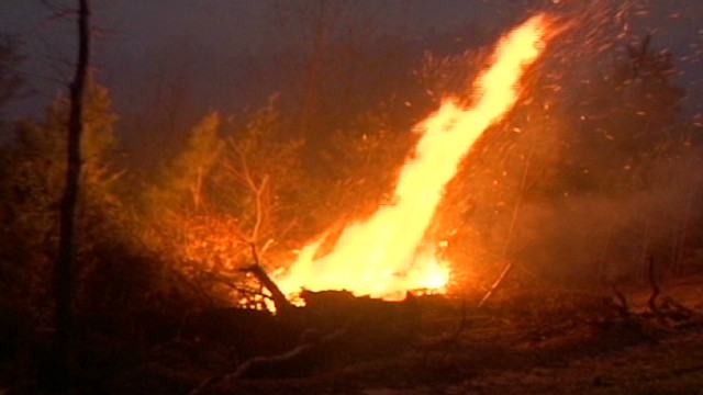 Tornado debris fuels wildfire in Alabama