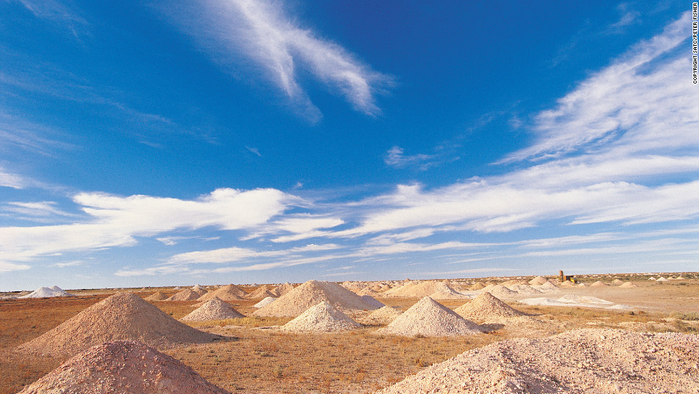 Mounds of tailings dot the landscape where opal miners sift through the earth.