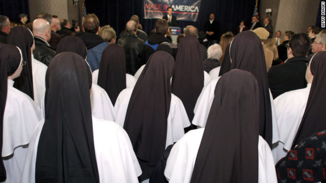 A group of Catholic nuns listens to former U.S. Sen. Rick Santorum  at a rally at a Knights of Columbus Council in Michigan.