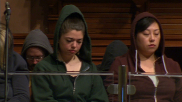 Worshippers wear hoodies at tribute